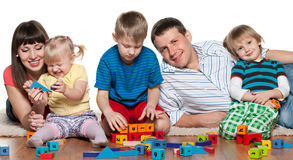 Family play on the floor Royalty Free Stock Photos