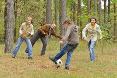 Family play football forest Stock Photos