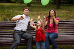 Family play with green balloon. Stock Images