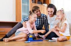 Family play at lotto game Royalty Free Stock Images