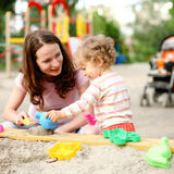 Family on playground. Happy family on playground in summer royalty free stock photos