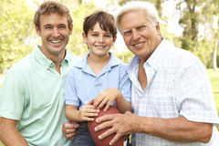 Family Playing American Football. Grandfather With Father And Son Playing American Football In The Park Stock Photography