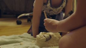 Family playing in the archeology destroys the plaster to get the skeleton. archaeological excavations.  stock video
