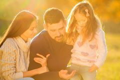 Family playing in autumn park having fun.  Stock Photo