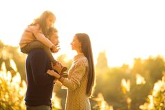 Family playing in autumn park having fun. At sunset.park at sunset of the day Royalty Free Stock Images