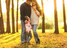 Family playing in autumn park having fun at sunset. Park at sunset of the day Royalty Free Stock Image