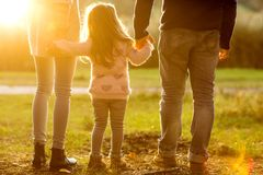 Family playing in autumn park having fun at sunset. Park at sunset of the day Royalty Free Stock Photo