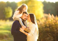 Family playing in autumn park having fun. Park at sunset of the day Royalty Free Stock Photos