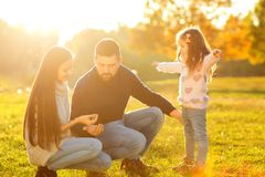 Family playing in autumn park having fun on sunset. Family playing in autumn park having fun Royalty Free Stock Image