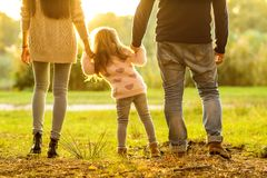 Family playing in autumn park having fun at sunset. Park at sunset of the day Royalty Free Stock Photos