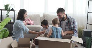 Family playing with baby girl in carton box stock footage
