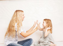 Family playing with baby. Mother playing with baby at home royalty free stock images