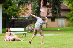 Family is playing badminton in summer Stock Images