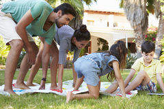 Family Playing Balancing Game In Garden Stock Photography