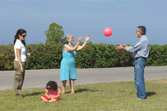 Family playing with a ball Royalty Free Stock Photo