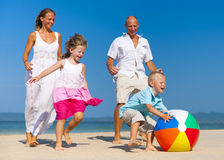 Family playing ball on beach Royalty Free Stock Images