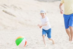 Family playing with ball at the beach Stock Photography
