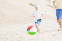 Family playing with ball at the beach Royalty Free Stock Image