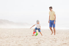 Family playing with ball Stock Photography