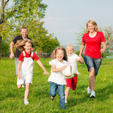 Family playing ballgames stock images