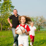 Family playing ballgames royalty free stock images