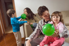 Family of Playing with Balloons Stock Photos