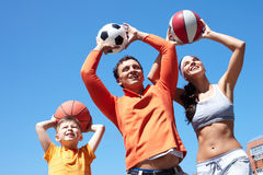 Family playing with balls Royalty Free Stock Photo