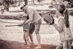 Family playing baseball in the park Royalty Free Stock Photography