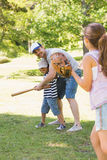 Family playing baseball in park Royalty Free Stock Images