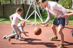 Family playing basketball. Caucasian family playing basketball together. Single father spending time with his children stock photography