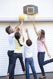 Family Playing Basketball Outside Garage Stock Images