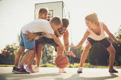 Family playing basketball together. On the move royalty free stock photo