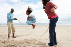 Family playing on beach. Having fun royalty free stock photos