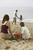 Family Playing on the Beach Royalty Free Stock Image