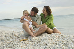 Family playing on beach stock photography