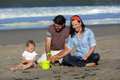 Family playing beach Stock Photos