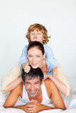 Family playing in bed with thumb up Royalty Free Stock Photography