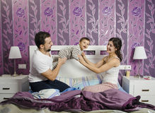 Family playing in bedroom Royalty Free Stock Image