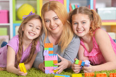 Family playing with blocks together. Portrait of a happy family playing with blocks together royalty free stock image