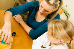 Family playing a board game. Together having a lot of fun royalty free stock photography