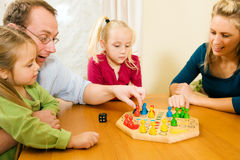Family playing a board game. Together having a lot of fun stock photography