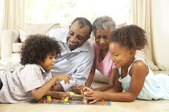 Family Playing Board Game At Home Stock Photography