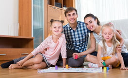 Family  playing at board game Stock Images
