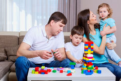 Family playing board game at home. Stock Image