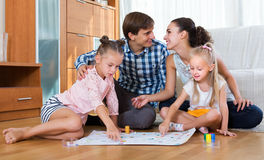Family playing at board game Royalty Free Stock Photo