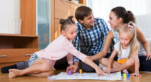 Family playing at board game Royalty Free Stock Photography