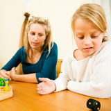Family playing a board game together Stock Photography