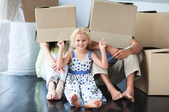 Family playing with boxes