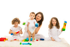 Family playing with building blocks Stock Photography