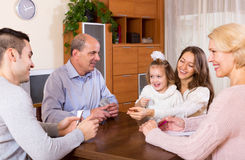 Family playing cards Stock Images